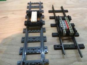 Left: Lego train wheels on Lego track. Right: SM32 chassis in Lego